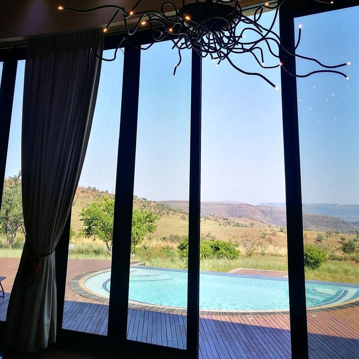 Looking through the awesome stacking folding doors at the breathtaking view of the Magaliesburg mountain range #hotel #hotels #southafrica  #instaphoto #doors #mountain #doorcollection #doorsupply #doorsoftheworld #soutafricalust #gautenglust #windorpro #sundayfunday #sundaydrive