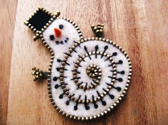 Artist: Odile Gova ~ Felt and zipper snowman brooch by woollyfabulous on Etsy, $30.00