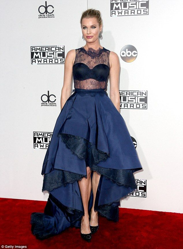 Blue beauty! Rebecca Romijn went for a daring blue look as she flashed her bra and toned tummy on the red carpet at the 2016 American Music Awards in Los Angeles on Sunday