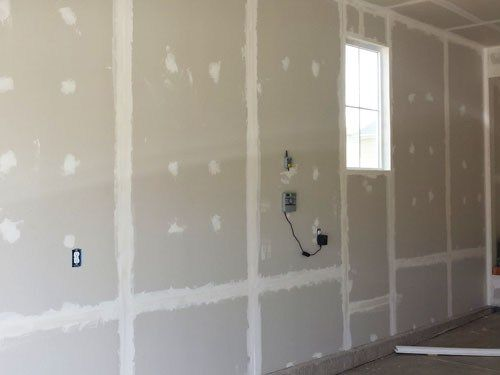 How To Finish A Garage How We Insulated And Drywalled Our New Garage Garage Renovation Garage Door Design Insulating Garage Walls