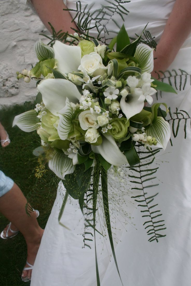 Bridal Bouquet - Green orchids, callas, roses and lily of the valley with berries, ferns and grasses.
