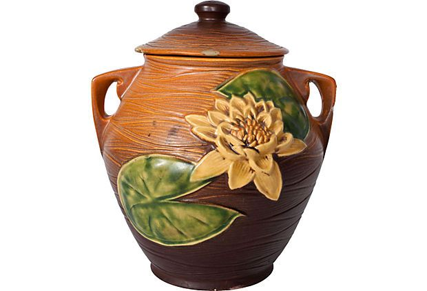$635.00  $950.00 Estimated Market Value    Era: Vintage  Condition: Very Good; small chip on handle, repair on lid  Roseville Water Lily Cookie Jar on OneKingsLane.com