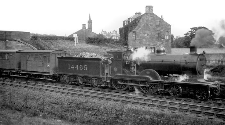 Caledonian Railway class 113 4-4-0 no. 14465 in LMS guise seen here at Annan with a stopping train. The drifting smoke and steam suggest that the loco is reversing but the visible footplate crew member is looking in the forward direction. 14465 was a Pickersgill designed engine built St. Rollox in 1916 and was something of a survivor receiving its BR number 54465 in September 1948 and soldiering on until eventual withdrawal from Motherwell shed in October 1962.