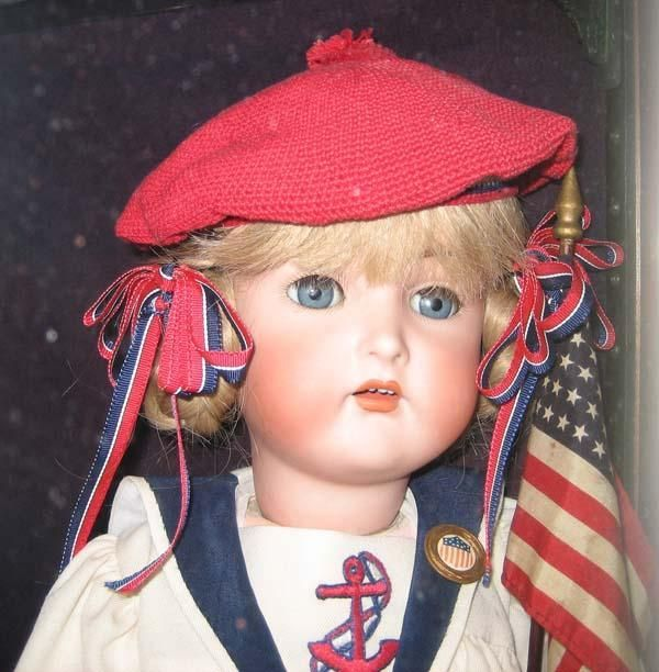 K*R antique bisque doll. 24. Compo body, great wool outfit. Love her face, wig, sailor outfit. Clothes have a few moth holes. Doll in very good