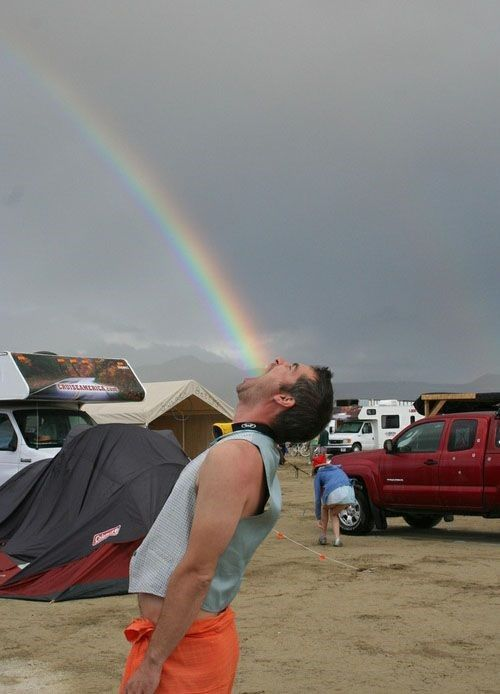 Forced Perspective- it makes you think the rainbow is coming out his mouth where in reality it is 1000000 miles away
