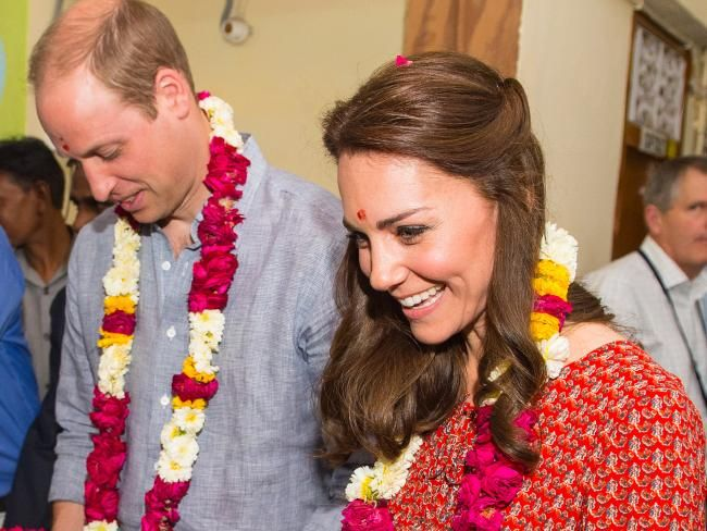 Embracing the culture in New Delhi, William and Kate are greeted with garlands at a contact centre run by the charity Salaam Baalak supporting homeless children. Picture: Dominic Lipinski/Getty