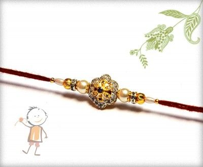 Fancy #Rakhi  Collection 2015 – Send #Rakhi to #India, #USA, #UK, #Canada, #Australia, #Dubai  #NZ #Singapore.  Pearls American Diamond Rakhi, surprise your loved ones with roli chawal, chocolates and a greeting card as it is also a part of our package and that too without any extra charges. http://www.bablarakhi.com/send-fancy-rakhi-online/745-send-pearls-american-diamond-rakhi-online.html