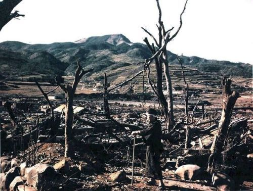 Dr. Nagai of Nagasaki Hospital inspecting damage caused by the atomic bomb, Nagasaki, Japan, 1945. Nagai would die of radiation poisoning a few days after this photo was taken. http://wrhstol.com/2iGjDNA