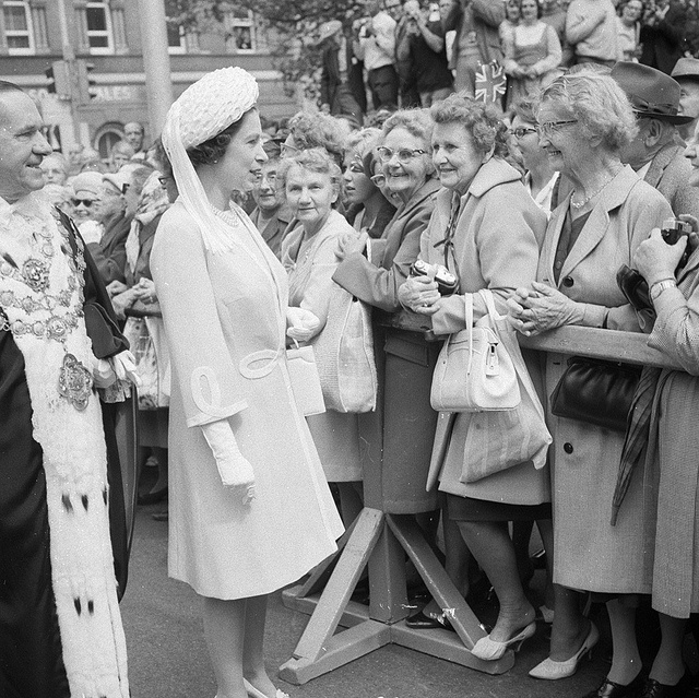 """Queen Elizabeth """"walkabout"""" on arriving at Sydney Town Hall for a civic reception during the tour for the Captain Cook Bi-Centenary Celebrations, 21 Apr 1970 / photographer Maurie Wilmott  Find more detailed information about this photograph:   http://acms.sl.nsw.gov.au/item/itemDetailPaged.aspx?itemID=126903  From the collection of the State Library of New South Wales www.sl.nsw.gov.au"""