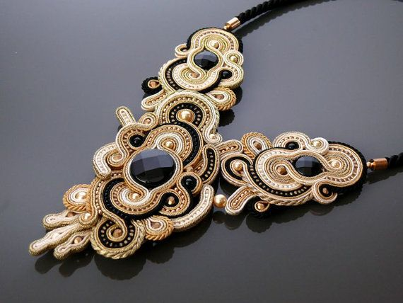 Beautiful, impressive soutache necklace, made from Soutache strings, onyx , Swarovski pearl and TOHO beads.  Pendant have been impregnated. Rear finished with natural leather.  Full length: 6.4 inches.  Length of string: 16.8 inches  Colour: ecru, beige, gold and black