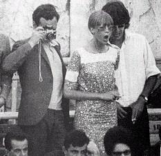 Pattie Boyd-Harrison, George Harrison, and Brian Epstein (attending a bullfight in Spain 1966)