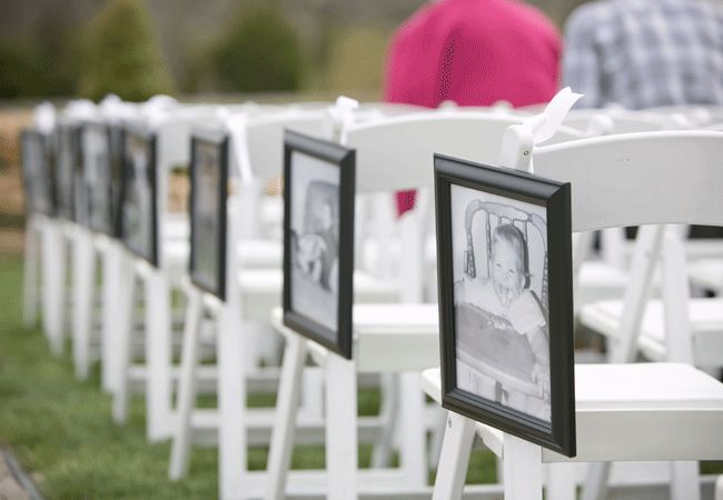 16 Creative Ways To Display Family Photos At Your Wedding | Photo by: Lark Photography | TheKnot.com