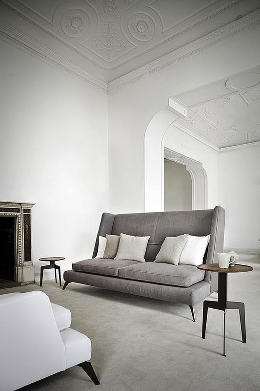 Gray high back modern wing sofa by designer Gianluigi Landoni.