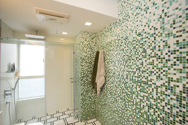 Mixed green mosaic tile in bathroom