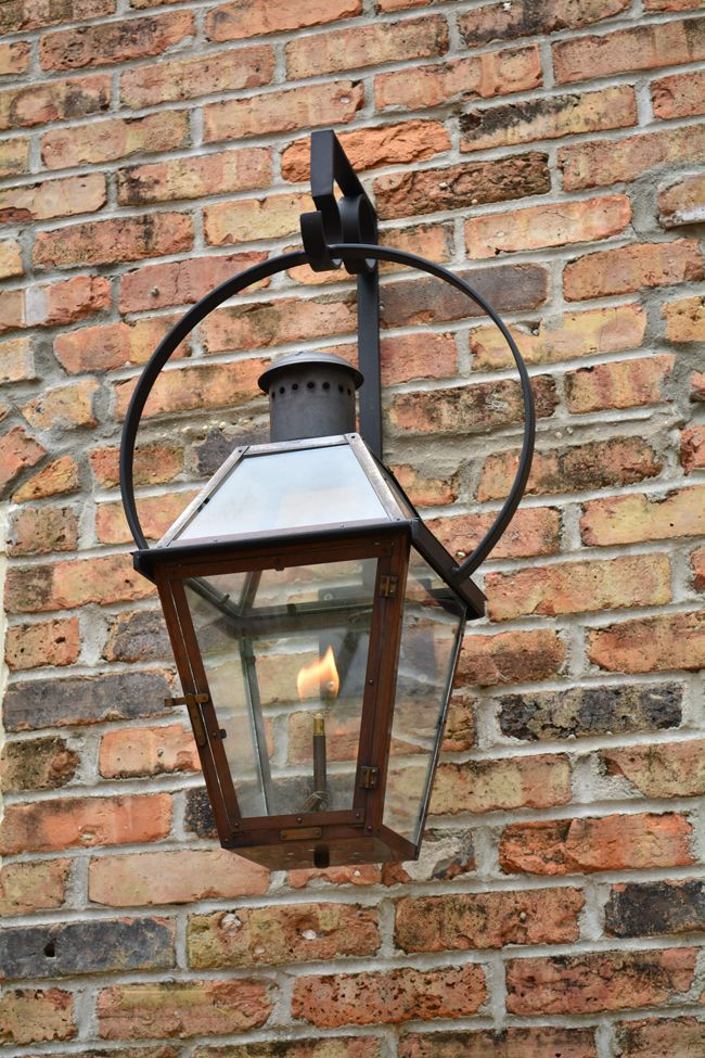 Flickering Bevolo Gas Lanterns add a soft romantic glow. Bevolo Pool House Lanterns and Patio Lights add soft layers of candle light. The French Quarter Lantern is a trademark of New Orleans and our first original design. #gaslanterns #bevolo
