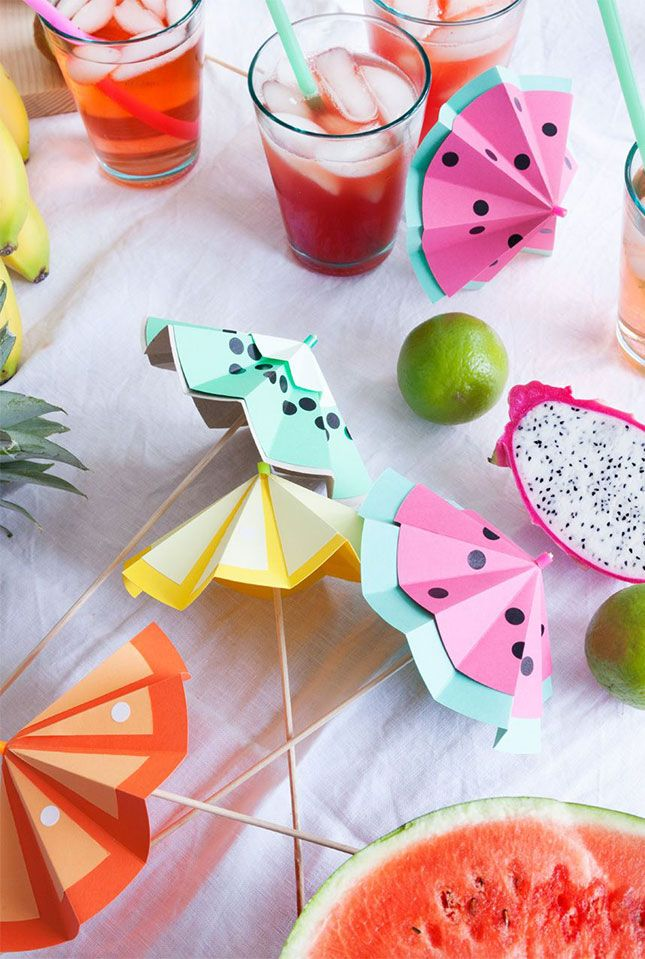 Love these DIY fruit paper cocktail umbrellas for a tropical-themed summer pool party.