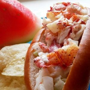 Maine lobster roll w/ chips and water mellon.