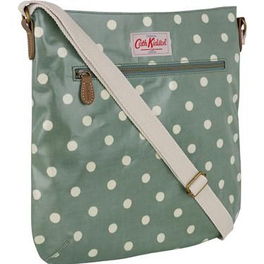Stylish and practical, our cross body bag is easy to wear with its adjustable strap and classic shape, and is great for holding all your daily essentials. This classic Spot print bag is completed in our durable oilcloth and finished with magnetic closure, zip interior and exterior pockets. Complement the look with our contrasting and coordinating handbag accessories.