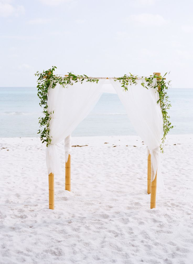 Simple beach ceremony arch | Photography: Austin Gros Wedding Photography - austingros.com  Read More: http://www.stylemepretty.com/2014/04/25/intimate-florida-beach-destination-wedding/