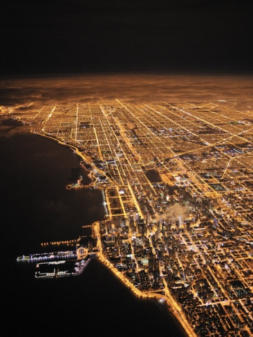 Chicago Glows in the Night as Clouds Drift in Off the LakeBy Jim Richardson