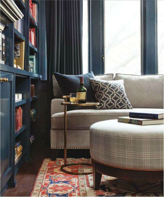 blue den meredith heron: The deep wood color and drapery and pillow selections makes this space cozy and cohesive.