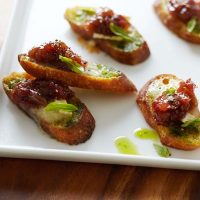 Brie and Basil Crostini with grape relish. A great play on the traditional brie with cranberry sauce. Recipe available at http://www.delish.com/recipefinder/Brie-and-Basil-Crost-25F2EBCC14E411DF8B765DA3E4102FB7