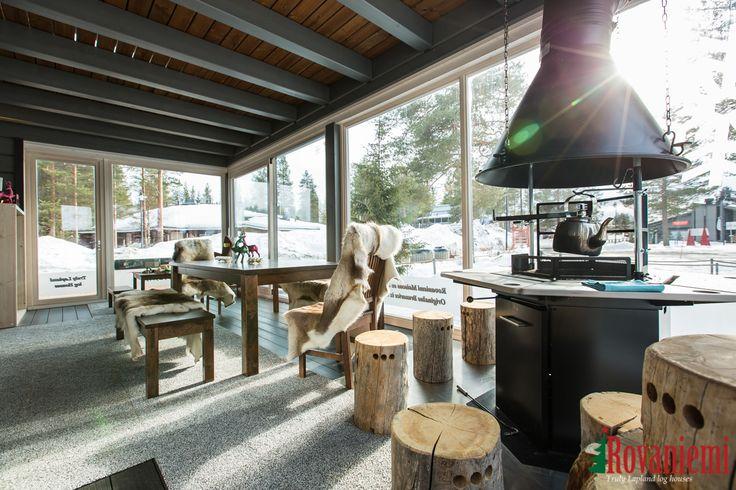 Kieppi – Rovaniemi Log House Head Office. Fireplace and terrace to have coffee.