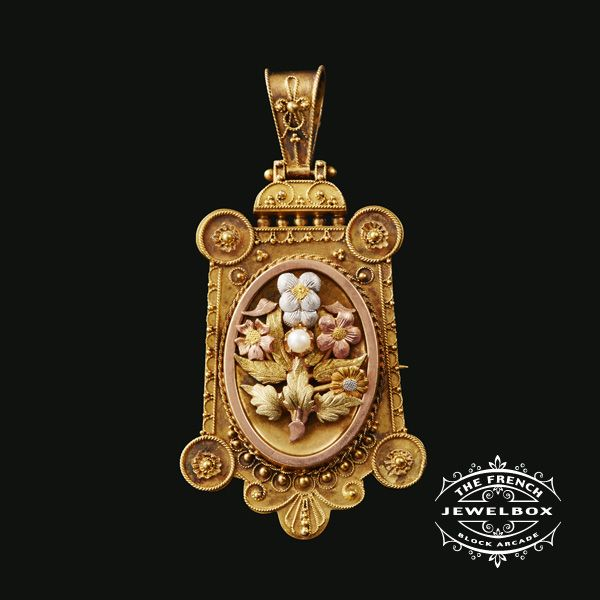 An outstanding example of Victorian Etruscan Revival work. Crafted in four coloured gold. Pendant with locket to reverse.
