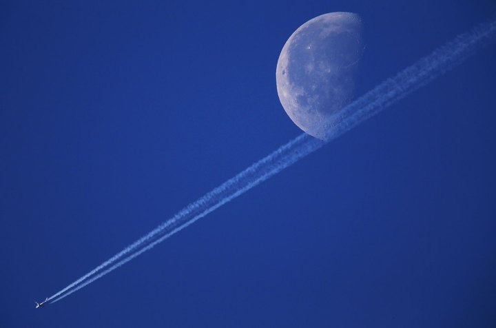 An airplane is pictured in front of the illuminated moon near Schwerin, Germany, Dec. 5 2012.