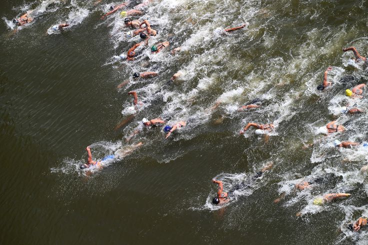 A general view as Keri-Anne Payne (C) of Great Britain leads the field away from the start in the Women's 10km Open Water Swimming Final on