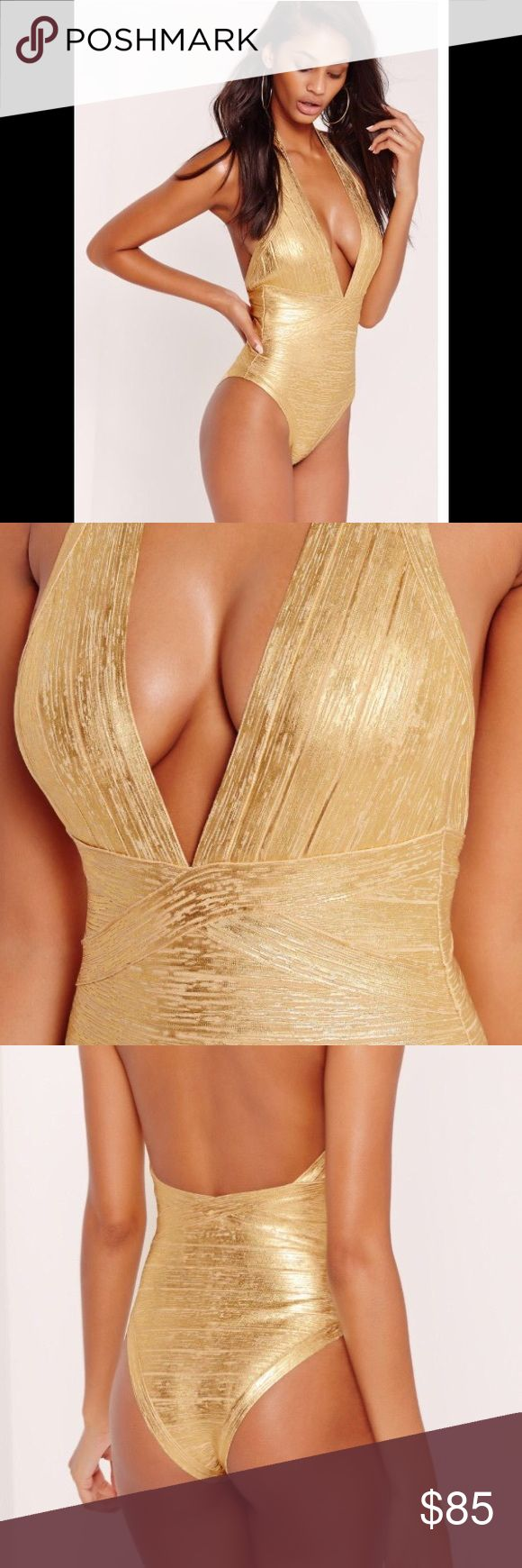 NWT PREMIUM FABRIC METALLIC GOLD BANDAGE SWIMSUIT NWT THIS ONE PIECE GOLD DEEP V NECK HALTER TOP SWIMSUIT WILL MAKE EVERY HEAD TURN! Made of a premium metallic golden 90% viscose, 9% nylon and 1% elastane fabric, it will hug your figure with a high shine finish to sparkle in the sun!!! Regular/stretch fit. Concealed back zipper. Hand wash. Missguided Swim One Pieces