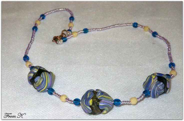 Everyday wear, casual wear #necklace. Czech crystals and seed beads are used as well as #polymer #clay hand marbled 8 petaled flowers fitted perfectly on top of the crystal. Fits on base of the neck. 45 cm long. (for details see this items in my albums https://www.facebook.com/BeadsFromK/photos)