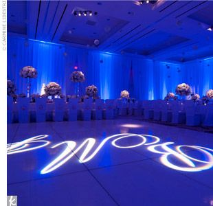 Royal Blue Wedding Decorations | ... royal-blue mood lighting creates a modern, formal atmosphere.Photo by