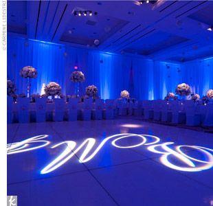 Royal Blue Wedding Decorations | ... royal-blue mood lighting creates a modern, formal atmosphere.Photo by
