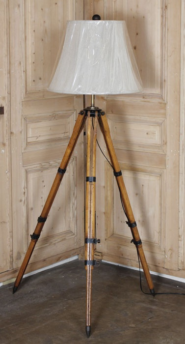 Antique Surveyors Transit Floorlamp.  Survived in remarkable condition, this surveyor's transit was converted to a floor lamp at one point in its history, and has been rewired to UL Standards by our expert in-house staff. Topped with a hand-sewn silk shade, it's the perfect choice for the engineer or construction industry tycoon!   Circa early 1900s.