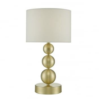 A modern touch table lamp with incremental sized spheres forming the shape of the base. Finished in a brushed gold finish, this comes complete with a white cotton drum shade. Simple perfection in living rooms and bedrooms. This light is double insulated, ensuring that it is safe to use in homes without an earth cable. This light is operated by a touch base, 3 stage dimmer (ensure that you choose dimmable bulbs).