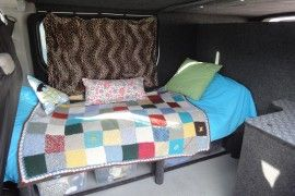 Hannah Barnes - Vauxhall Vivaro van conversion with bed and bike shed.