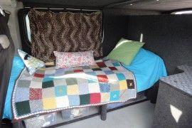 Hannah Barnes - Vauxhall Vivaro van conversion with bed and bike shed.