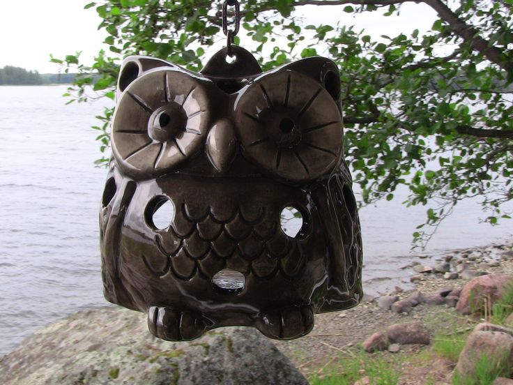 Ceramic brown owl. Place inside the owl a small candle and hung the owl by a chain. So simple but still sweet element of decor. Owl is suitable for outdoor use.