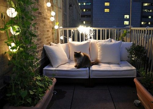What a great way to make use of a small space! City or country, I'd love to curl up here.