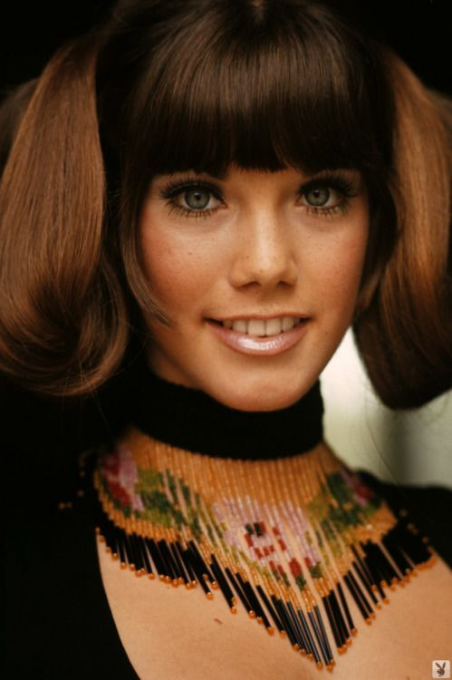 1960s hair, makeup, and necklace.
