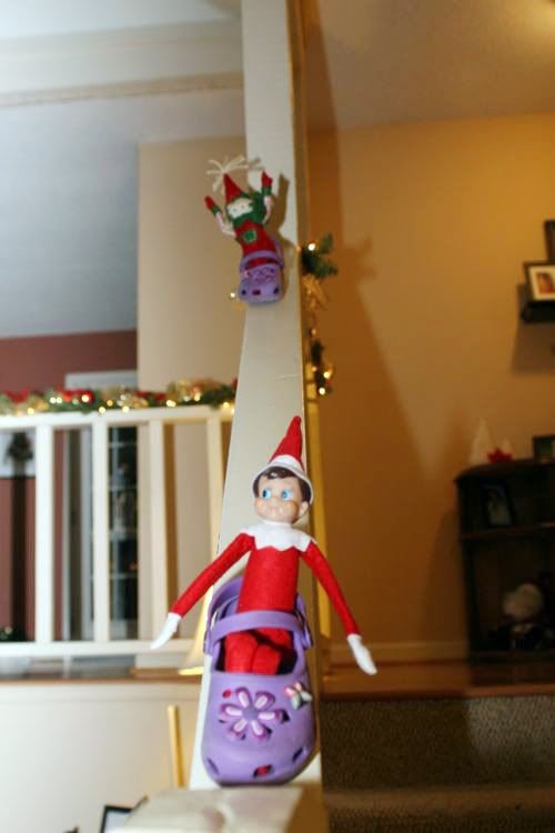 Elf on the shelf- Sleigh (shoe) riding on the stairs. I LOVE this.  Not sure how it would work in our house with an actual railing...hmmm