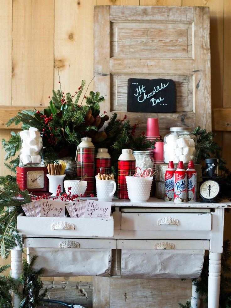 Rustic hot chocolate bar with plaid thermoses, whipped cream, marshmallows and other toppings