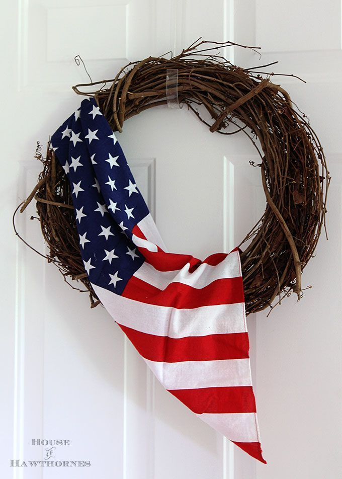 THIS IS AWESOME!  Learn how to make this patriotic flag wreath.  It's one of the EASIEST DIY 4th of July or Memorial Day decor ideas out there.  (Psst!  Want to know a secret?  It's not a real flag, so you don't have to worry about harming a flag by using