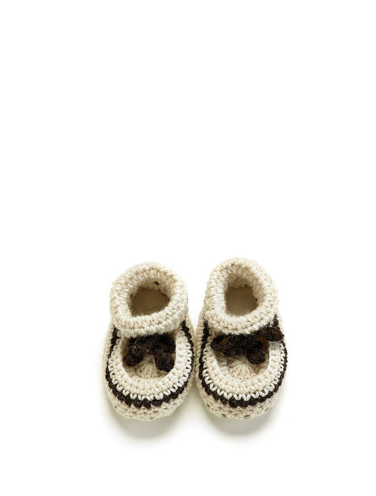 Need a gift for a special new person, crochet bootees made with all natural wool and sheepskin, perfect for keeping small toes warm. With sizes starting at new born they are the perfect baby shower gift.  (http://www.classicsheepskins.com/baby-crochet-bootee/)