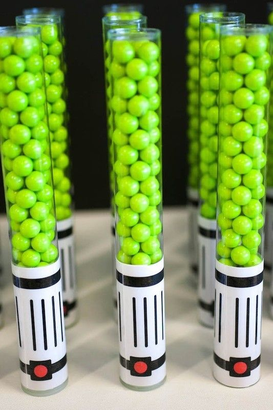 Star Wars party idea: Fill a candy tube with Sixlets and add a printable handle to make a delicious Lightsaber party favor   Petite Party Studio