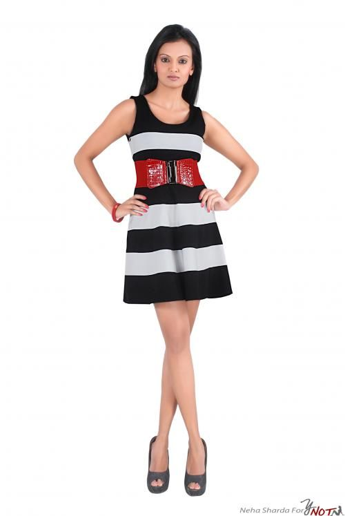 Black White Sleeveless Bandage Dress With Waist-belt By : Neha Kamal Sharda Description   This outfit is in the most preferred colour combination of Black & White. This is a sleeveless bandage dress in jersey material and comes with a red waist-belt .