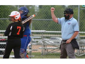 Jason Booth calls a strike during a high school softball game between Frankfort High and Paris. Booth has been a softball umpire for 20 years. (Photos submitted)