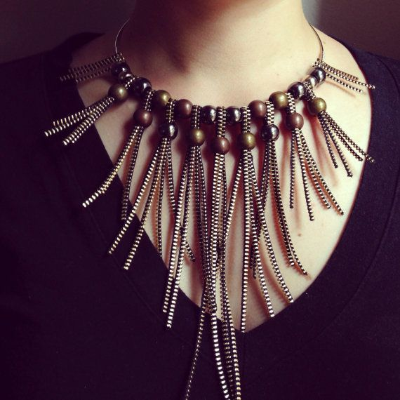 Gold Zipper Graded Bib Statement Necklace With Metal Beads    Zipper: gold on black  Wire: gold plated  Metal Beads