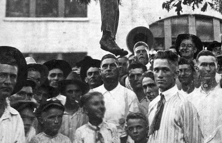 """""""A postcard dated August 3, 1920, depicts the aftermath of a lynching in Center, Texas, near the Louisiana border. According to the text on the other side, the victim was a 16-year-old boy."""" Oh, such a high-old time was had by all that Texas mob of church-going (so-called """"Christian"""") folk, eager to get their smiling faces in the picture.  :("""